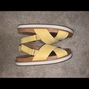 Yellow slip on sandals